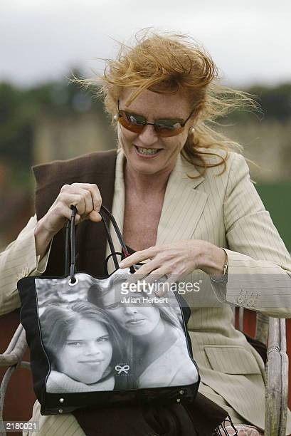 The Duchess of York Sarah Ferguson at Cowdray Park Polo Club Midhurst on July 17 2003 with her hand bag featuring pictures of her daughters...