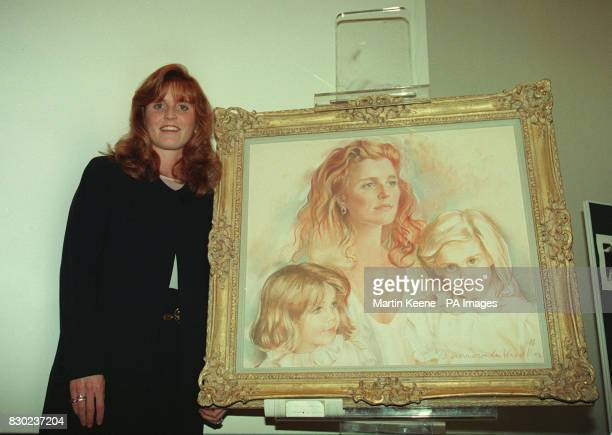 The Duchess of York Sarah Ferguson with a portrait of herself with the two Princesses Beatrice and Eugenie at the opening of an the 'Portraits in...