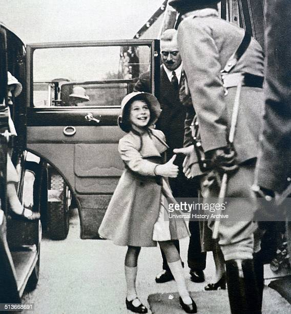 The Duchess of York took the children to see a daylight dress rehearsal of the Aldershot Tattoo Here Princess Elizabeth greets the officer of the...