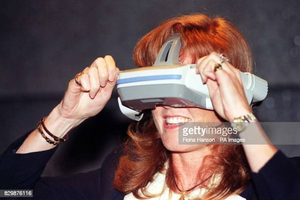 The Duchess of York tries a virtual reality game called Space Mission during a visit to Segaworld's high tech theme park which opened in the...