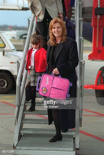 The Duchess Of York With Her Daughters Princess Beatrice And Princess Eugenie Arriving At Geneva Airport For A Skiing Holiday In Verbier Switzerland