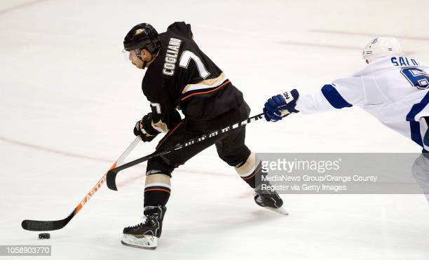 The Ducks' Andrew Cogliano takes a shot on goal as the Tampa Bay Lightning's Sami Salo tries to block at Honda Center in Anaheim on November 22 2013
