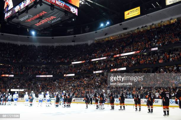 The Ducks celebrate the victory and shake hands with the Oilers during game 7 of the second round of the 2017 NHL Stanley Cup Playoffs between the...
