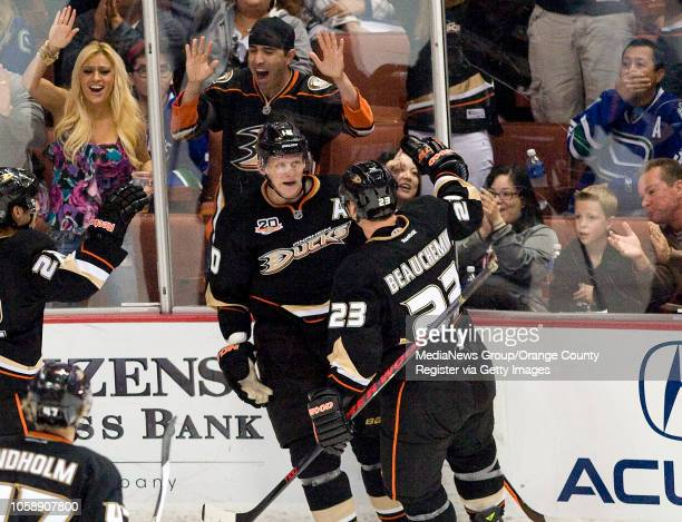 The Ducks' Corey Perry celebrates his goal with teammate Francois Beauchemin during their game against Vancouver at Honda Center in Anaheim on...