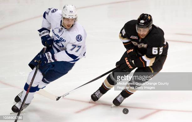 The Ducks' Emerson Etem chases the puck with the Tampa Bay Lightning's Victor Hedman at Honda Center in Anaheim on November 22, 2013.