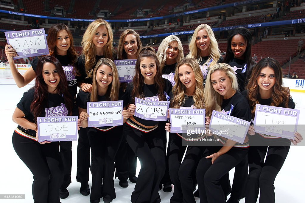 The Ducks Power Players pose for a photo with their Hockey Fights Cancer posters prior to the game between the Anaheim Ducks and the Nashville Predators on October 26, 2016 at Honda Center in Anaheim, California.
