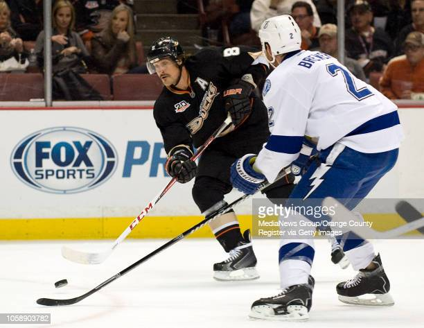 The Ducks' Teemu Selanne gets past the Tampa Bay Lightning's Eric Brewer at Honda Center in Anaheim on November 22, 2013.