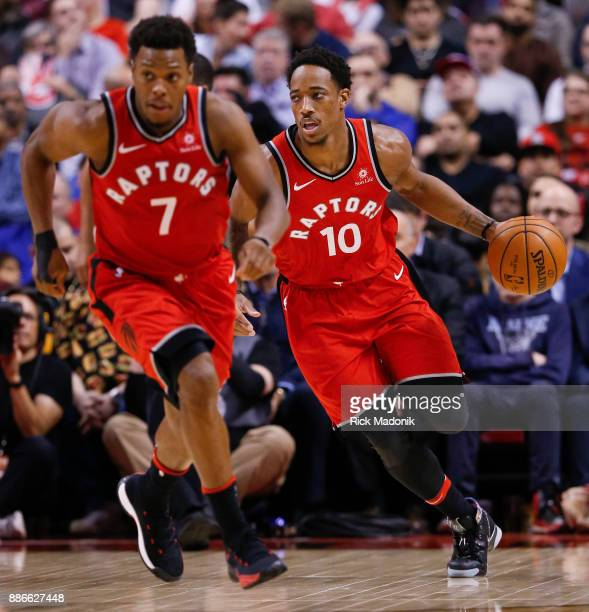 The due head up court with Toronto Raptors guard DeMar DeRozan handling the ball and Toronto Raptors guard Kyle Lowry heading to the front court...