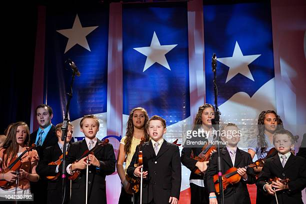 """The Duggar Family of The Learning Channel TV show """"19 Kids and Counting"""" participate in a musical performance at the Values Voter Summit on September..."""