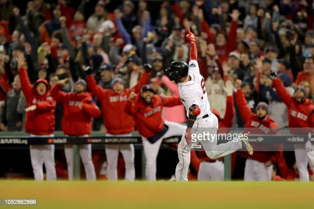 The dugout reacts as Eduardo Nunez of the Boston Red Sox celebrates his threerun home run during the seventh inning against the Los Angeles Dodgers...