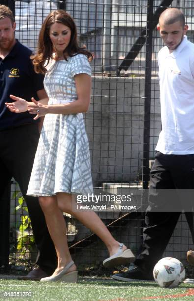 The Duke and Duchess of Cambridge and Prince Harry arrive at Bacon's College in Greenwich, London to attend the launch of a new sports project that...