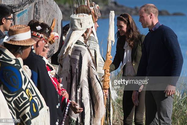 The Duke and Duchess of Cambridge are greeted by Haida First Nation chiefs in Haida Gwaii British Columbia on September 30 2016 / AFP / POOL / DARRYL...