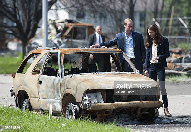 The Duke And Duchess Of Cambridge Inspect A Fire Damaged Car As They Walk Through Slave Lake Alberta Canada