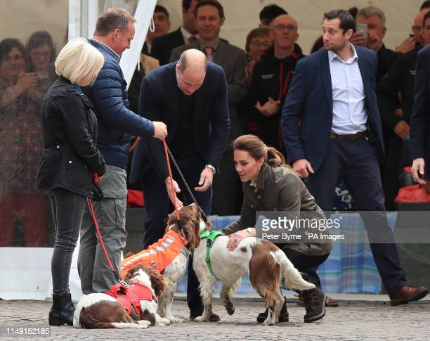 The Duke and Duchess of Cambridge meet working dogs on a walkabout in Keswick town centre during a visit to Cumbria.