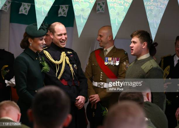 The Duke and Duchess of Cambridge talk to guardsman Bogg meets with Irish Guards after attending the St Patrick's Day parade at Cavalry Barracks in...