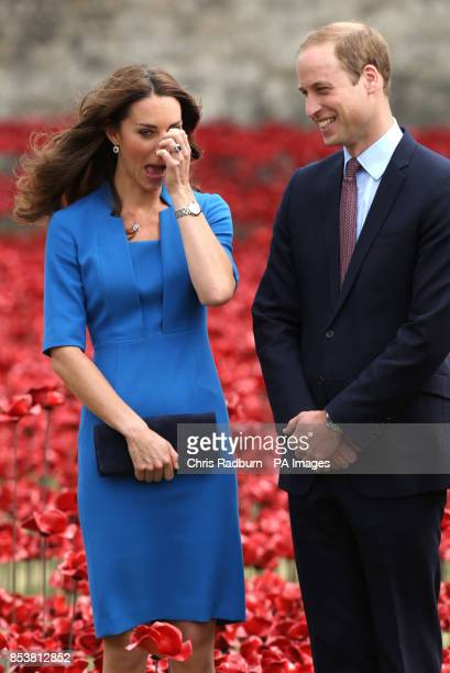 The Duke and Duchess of Cambridge view the Tower of London's 'Blood Swept Lands and Seas of Red' poppy installation which commemorate the 100th...