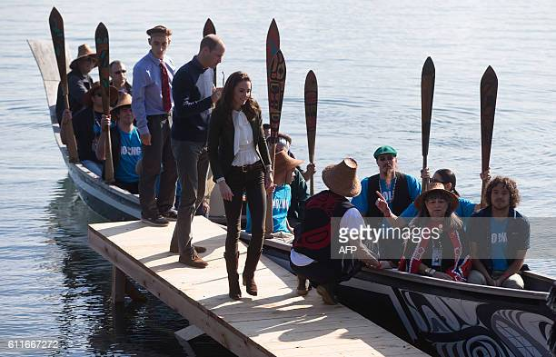 The Duke and Duchess of Cambridge walk on a dock after paddling a canoe to shore with members of the Haida First Nation in Haida Gwaii British...