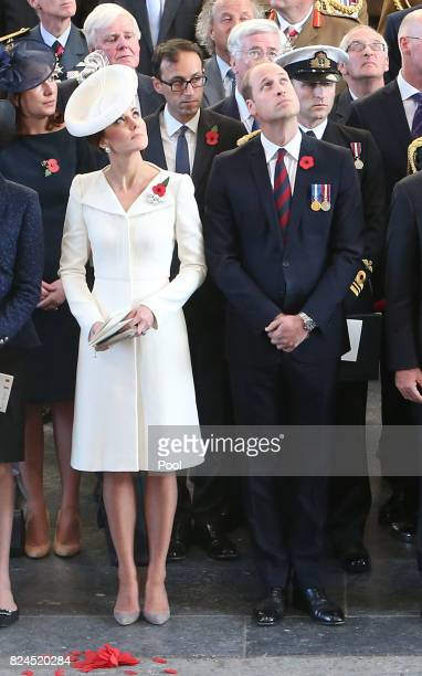The Duke and Duchess of Cambridge watch as the poppies fall from the roof of the Menin Gate in Ypres, Belgium for the official commemorations marking...