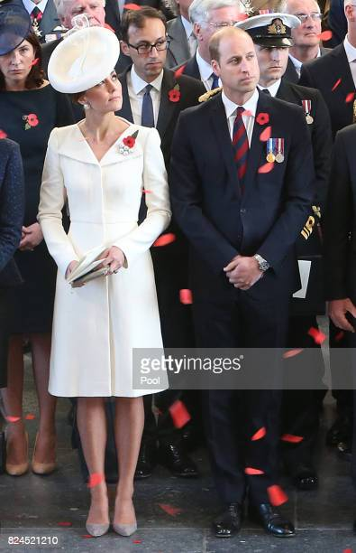 The Duke and Duchess of Cambridge watch as the poppies fall from the roof of the Menin Gate for the official commemorations marking the 100th...