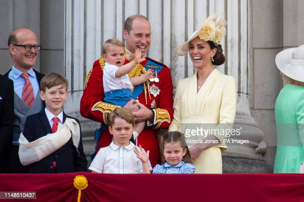 The Duke and Duchess of Cambridge with their children, Prince Louis, Prince George, Princess Charlotte, on the balcony of Buckingham Place watch the...