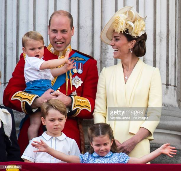The Duke and Duchess of Cambridge with their children, Prince Louis, Prince George and Princess Charlotte, on the balcony of Buckingham Place as they...