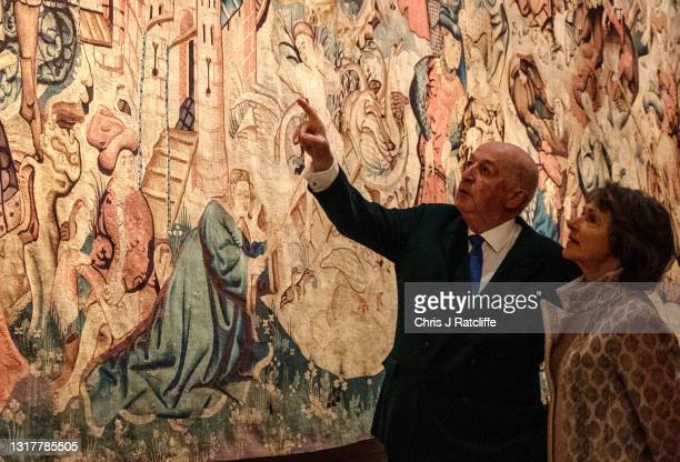The Duke and Duchess of Devonshire look at the Devonshire Hunting Tapestries at their home, Chatsworth House on May 13, 2021 in Bakewell, England....