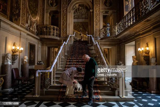 The Duke and Duchess of Devonshire pet their dog Max during a photocall at their home, Chatsworth House on May 13, 2021 in Bakewell, England....