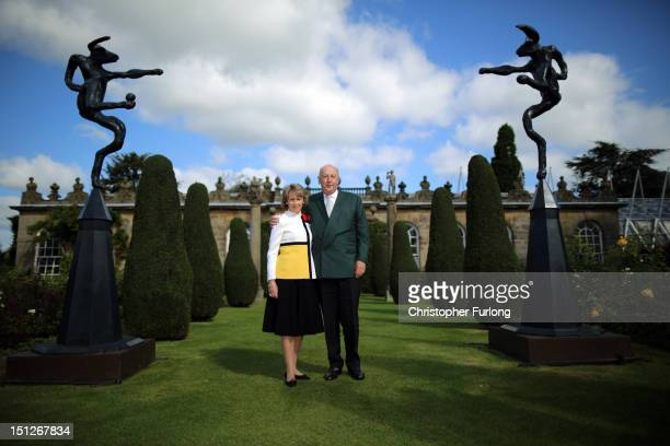 The Duke and Duchess of Devonshire pose for a photo between the sculptures 'Large Mirror Nijinski, by Barry Flanagan , which is part of the annual...
