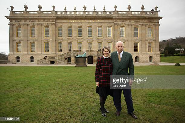 The Duke and Duchess of Devonshire pose for photographs in the grounds of Chatsworth House as they view the 'Caro at Chatsworth' exhibition of Sir...