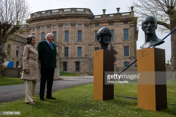 The Duke and Duchess of Devonshire pose for photographs next to sculptures of Elizabeth Frink at their home, Chatsworth House on May 13, 2021 in...