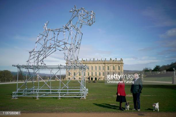 The Duke and Duchess of Devonshire pose for photographs with their rescue dogs Treacle and Max next to 'Dog Scaffolding Sculpture' an eight metre...