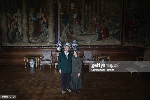 The Duke and Duchess of Devonshire pose next to the renovated Mortlake Tapestries at Chatsworth House on March 16 2016 in Chatsworth England...
