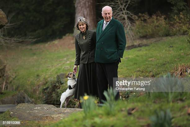 The Duke and Duchess of Devonshire pose with their dog Max for a portrait in Chatsworth's ornamental Trout stream and Paxtons rockery garden whiuch...