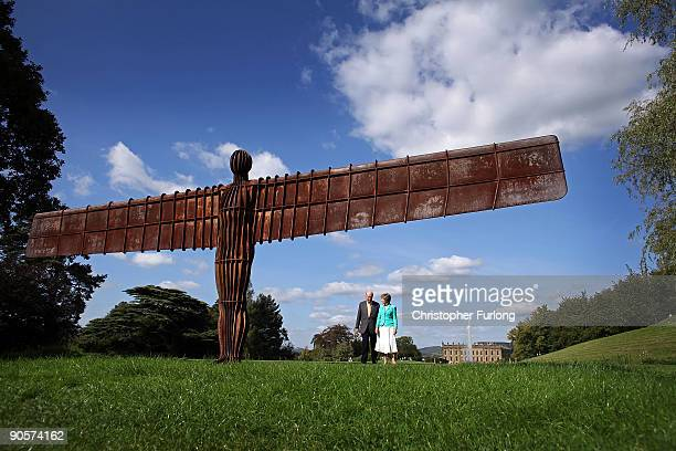 The Duke and Duchess of Devonshire view Antony Gormley's Angel of the North life size maquette in the gardens of their home Chatsworth House on...