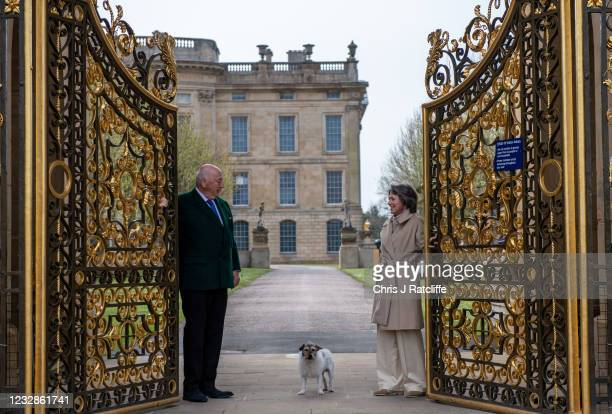 The Duke and Duchess of Devonshire, with their dog Max, pose for photographs at the gates to their home, Chatsworth House on May 13, 2021 in...