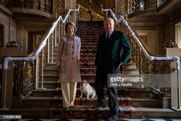 The Duke and Duchess of Devonshire, with their dog Max, pose for photographs at their home, Chatsworth House on May 13, 2021 in Bakewell, England....