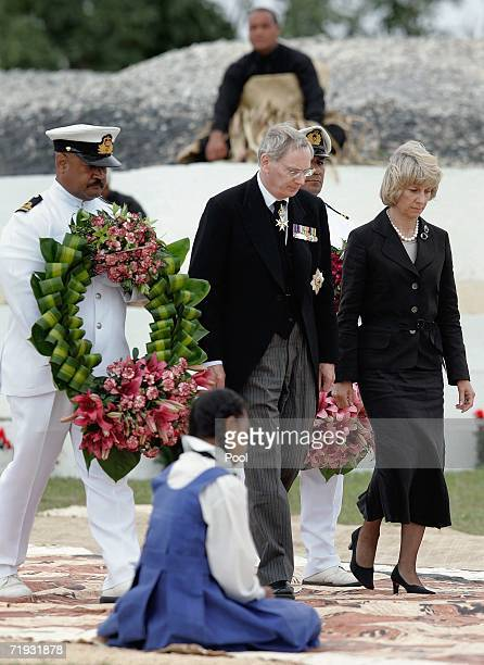 The Duke and Duchess of Gloucester deliver a wreath for the tomb for the tomb of the late King Taufa'ahau Tupou IV at his state funeral on September...