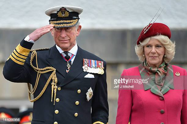 The Duke and Duchess of Rothesay take a royal salute from Armed Forces and Royal British Legion members during a march at the Palace of Holyroodhouse...