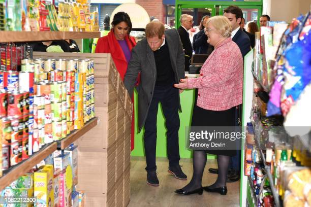 The Duke and Duchess of Sussex are shown around by manager Kay Penkethman as they officially open Number 7 a Feeding Birkenhead citizens supermarket...