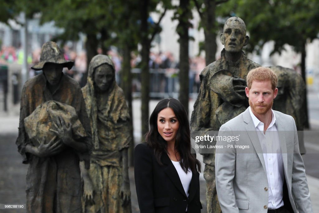 The Duke and Duchess of Sussex at the Famine Memorial, on the second day of their visit to Dublin, Ireland.