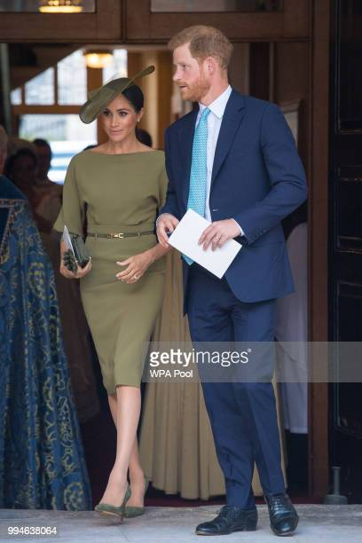 The Duke and Duchess of Sussex depart after attending the christening of Prince Louis at the Chapel Royal St James's Palace on July 09 2018 in London...