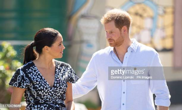 The Duke and Duchess of Sussex during a visit to the Nyanga Township in Cape Town, South Africa, on the first day of their tour of Africa. PA Photo....