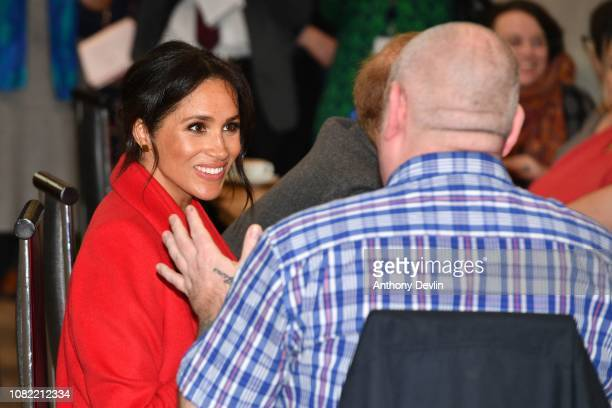 The Duke and Duchess of Sussex have a slice of cake and drink of coffee as they meet members as they officially open Number 7 a Feeding Birkenhead...