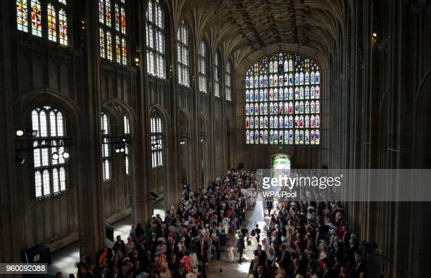 The Duke and Duchess of Sussex leave St George's Chapel at Windsor Castle following their wedding ceremony in St George's Chapel at Windsor Castle on...