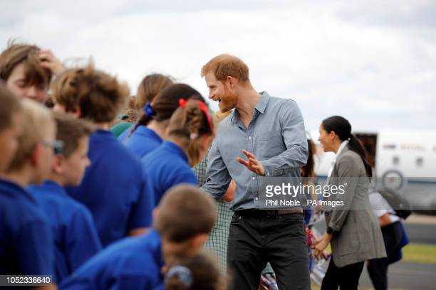 The Duke and Duchess of Sussex meet children from Dubbo South Public School after arriving by plane at Dubbo Australia on the second day of the Royal...