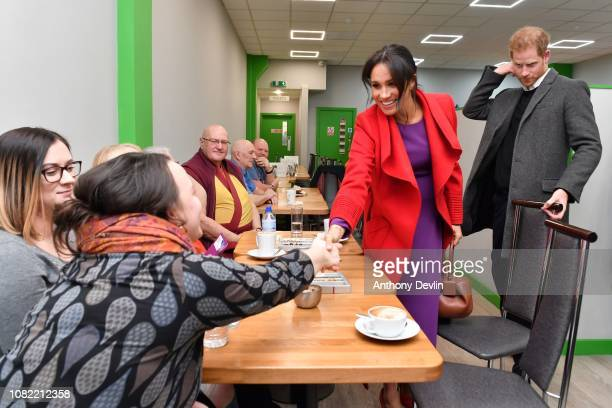 The Duke and Duchess of Sussex meet members as they officially open Number 7 a Feeding Birkenhead citizens supermarket and community cafe on January...