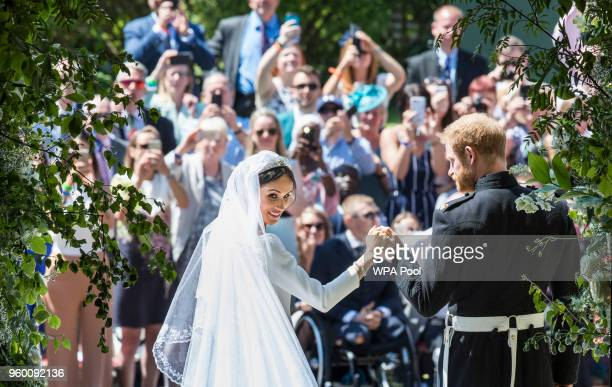 The Duke and Duchess of Sussex on the steps of St George's Chapel at Windsor Castle following their wedding ceremony in St George's Chapel at Windsor...
