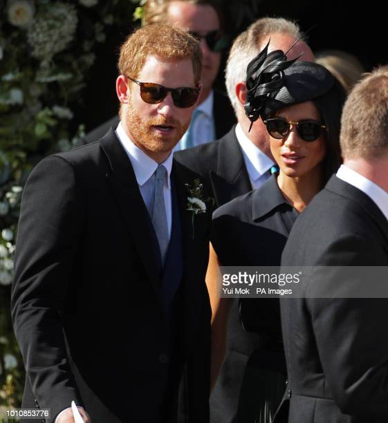 The Duke and Duchess of Sussex outside St Mary the Virgin Church in Frensham Surrey after attending the wedding of Charlie van Straubenzee and Daisy...