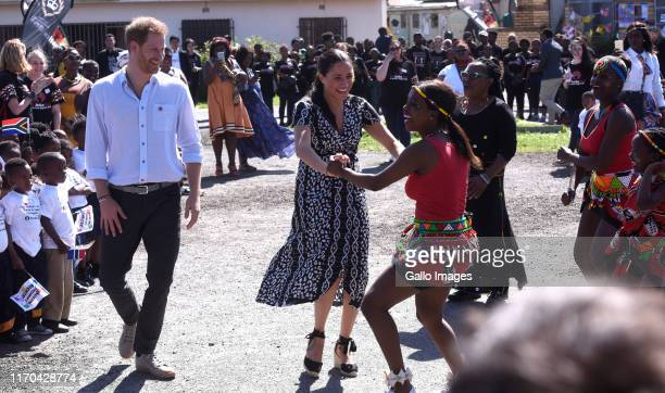 The Duke and Duchess of Sussex Prince Harry and his wife Meghan interact with children during The Duke and Duchess of Sussex visit to Nyanga Township...