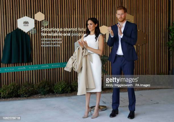 The Duke and Duchess of Sussex react during a ceremony at Taronga Zoo in Sydney Australia